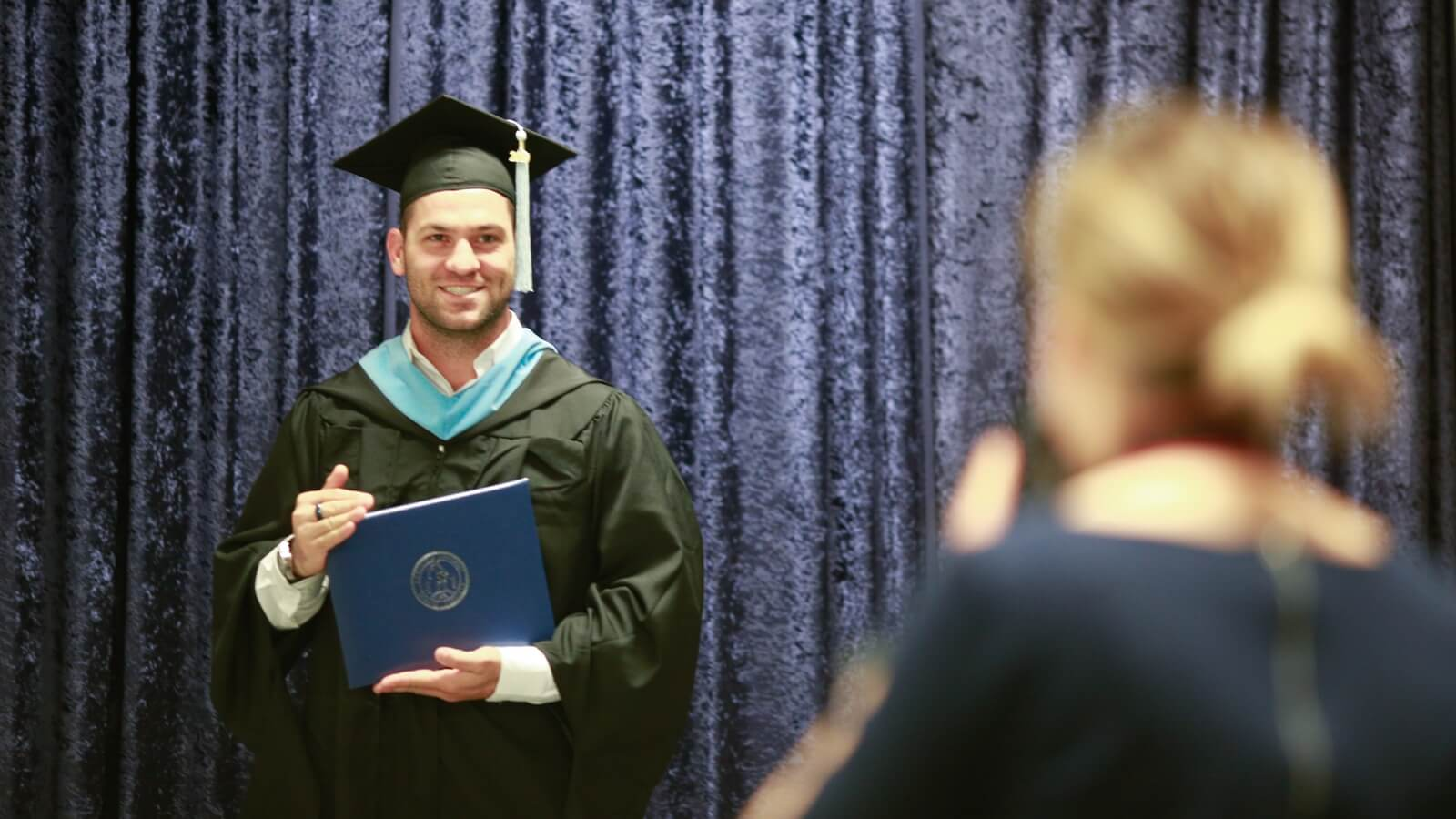 Student taking a graduation photo