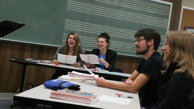 Four music education majors participate in a class discussion.