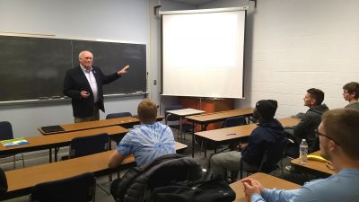 Kenlon Johannes '71 presents to an ag class at Concordia